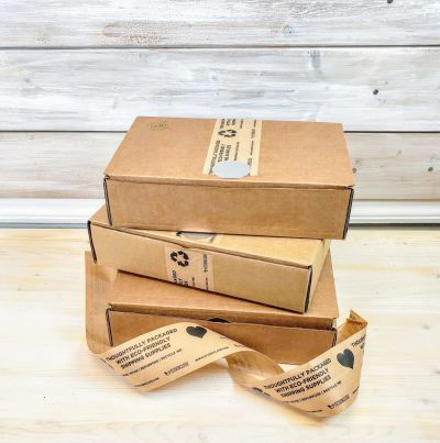 Eco-Friendly Boxes piled with eco-friendly shipping tape